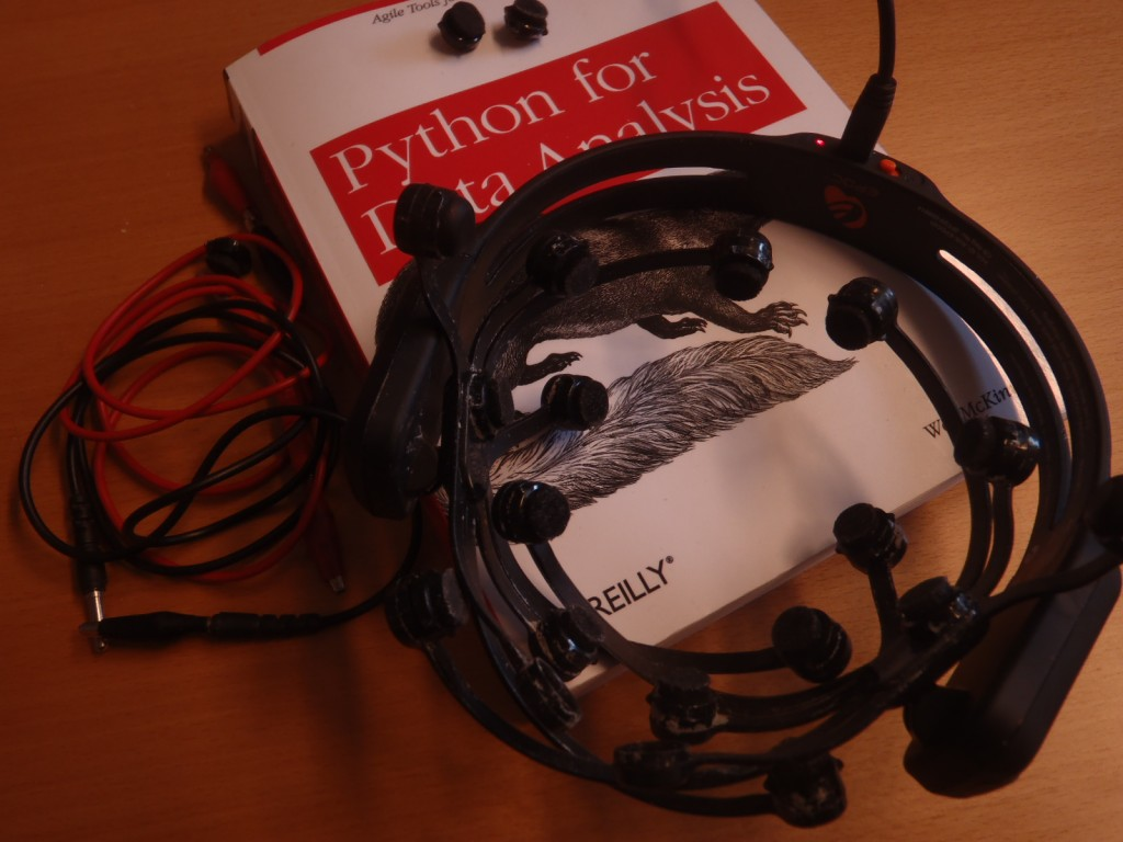 The low-cost EEG wireless headset together with a book on data analysis with Python using the pandas library.